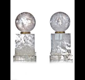 Pair cut rock crystal ball ornaments.
