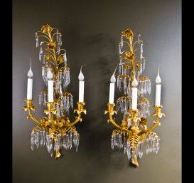 A pair of elegant Antique French Louis XVI ormolu bronze & cut crystal wall sconces.